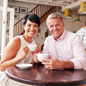 Older couple smiling because of quality New York cosmetic dental treatments