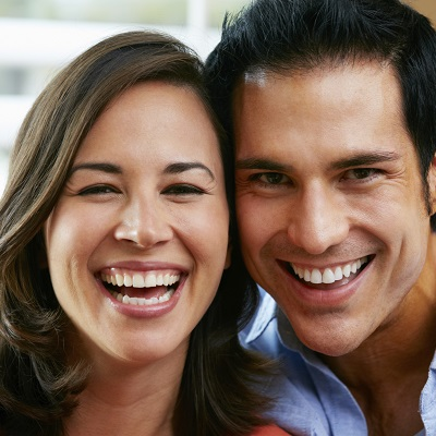 Older couple smiling because of quality New York Dental treatments