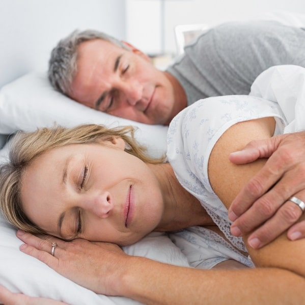 Peacefully sleeping couple because of sleep apnea treatment.